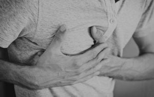 man clutching his chest